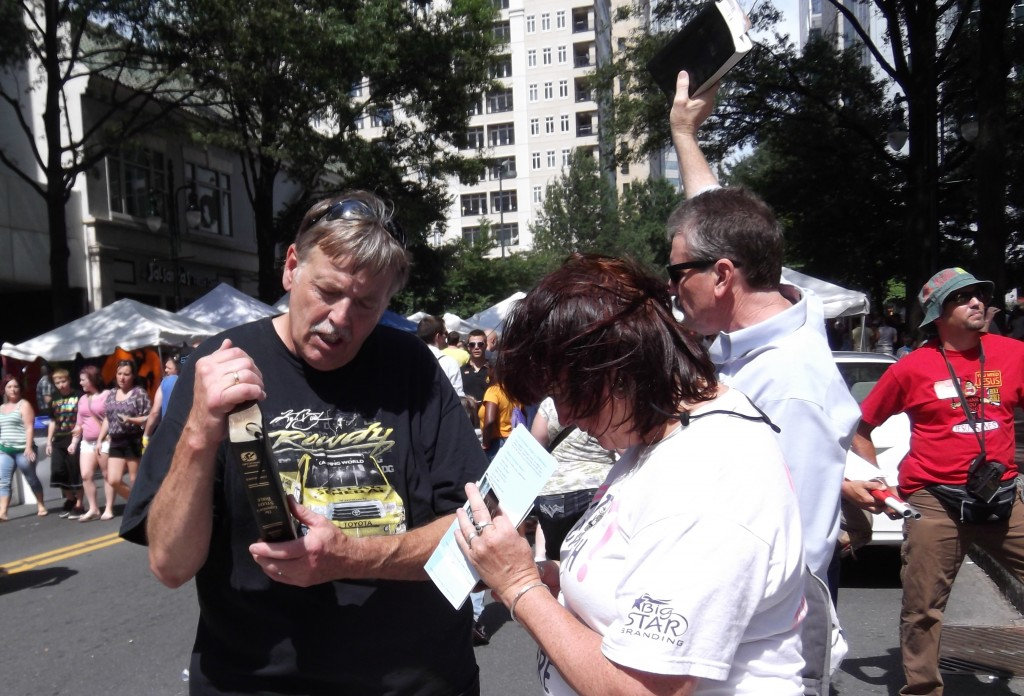 Ignoring street preacher and updating Facebook and Twitter.