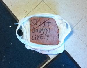 The tossed brick
